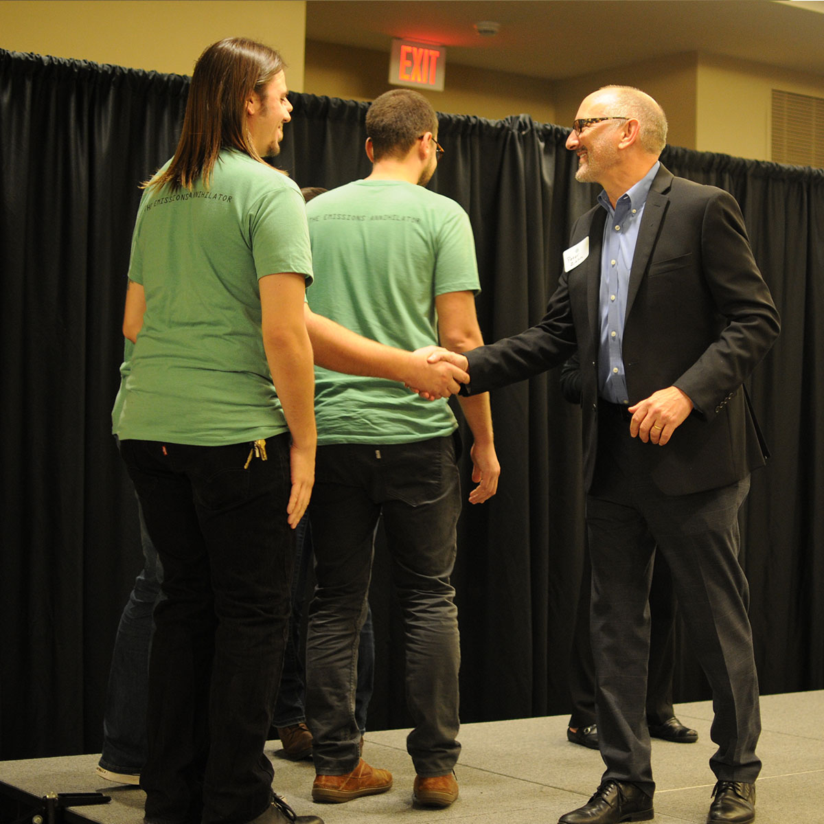 Recyclinator Team on stage shaking hands with Peter Zahn