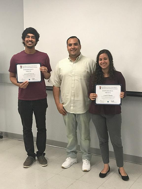 Ashwant Vinayak and Caselle Reinke, E-Track graduates.